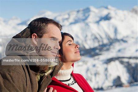 Young couple enjoying winter sun