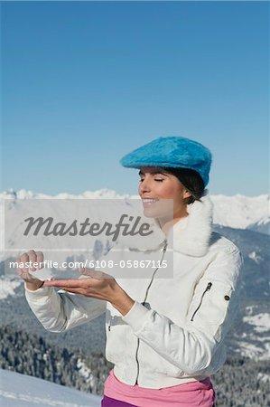 Young woman applying moisturizer