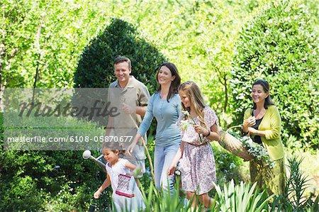 Happy multi generation family enjoying in the garden