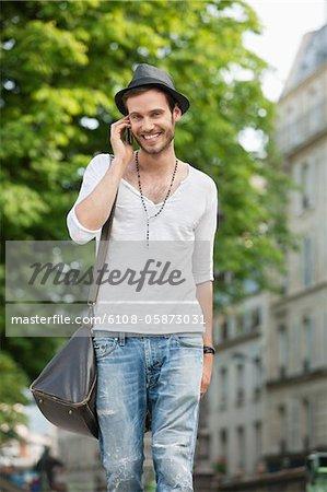 Portrait of a man talking on a mobile phone, Paris, Ile-de-France, France