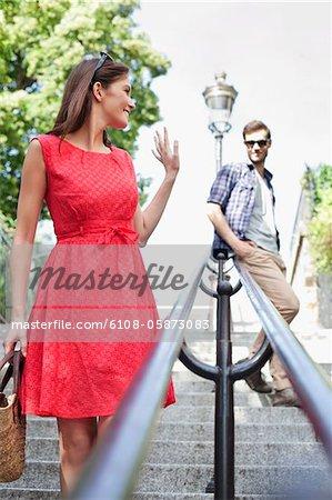 Woman waving to her husband, Montmartre, Paris, Ile-de-France, France
