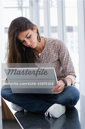 Beautiful woman using a laptop