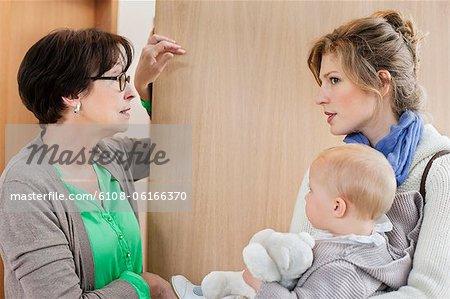 Woman talking to nanny at the doorway