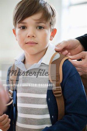 Portrait of a schoolboy with schoolbag