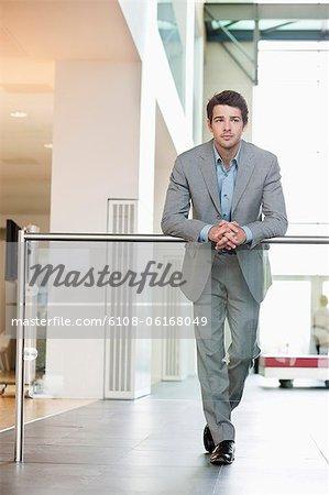 Businessman standing in an office corridor