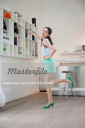 Woman cleaning a bookshelf