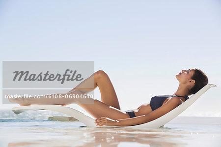 Beautiful woman sunbathing on the beach