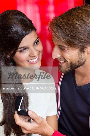 Man proposing his girlfriend in a restaurant