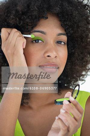 Portrait of a woman applying eyeshadow
