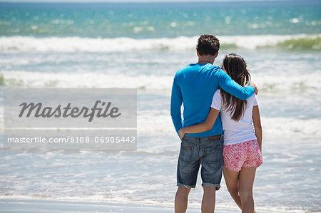 Couple enjoying good time on the beach