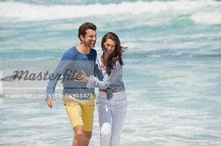 Couple enjoying on the beach