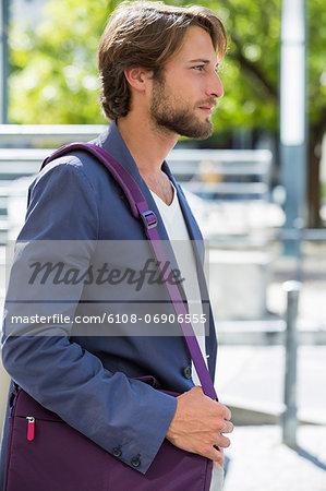 Man carrying a shoulder bag
