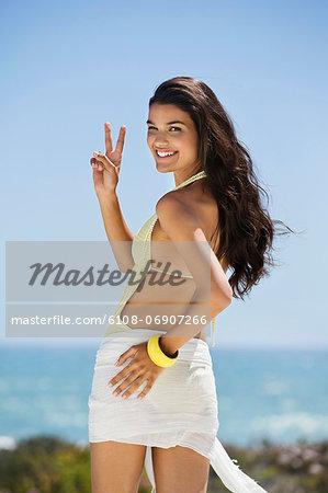 Beautiful woman gesturing on the beach