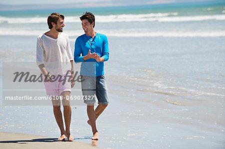 Two men walking on the beach