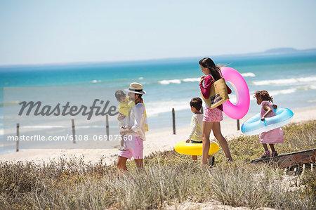 Family walking on a boardwalk on the beach