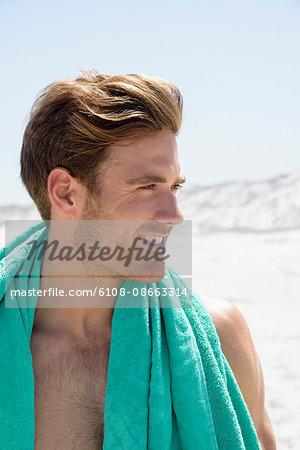 Happy young man enjoying on the beach