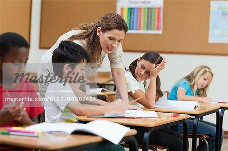 Side view of helpful elementary teacher