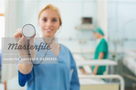 Focus on a nurse holding a stethoscope