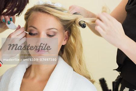 Beautiful woman getting prepared for the wedding wearing a bath robe