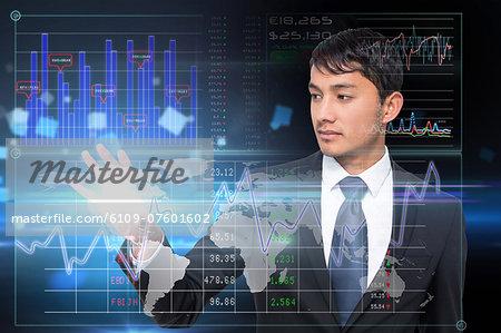 Asian businessman touching data interface