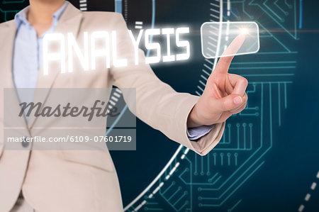 Businesswomans finger touching analysis button