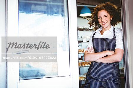 Pretty barista smiling at the camera