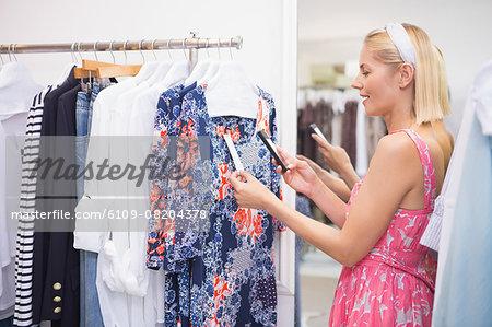 Woman taking photo of price tag