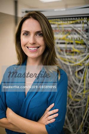 Confident technician smiling at camera