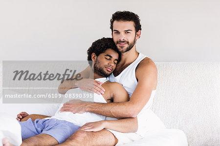 Smiling man hugging his sleepy partner
