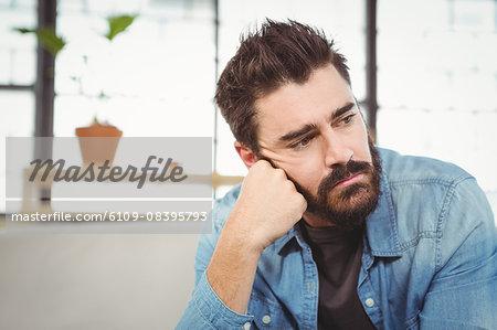 Close-up of worried man looking away