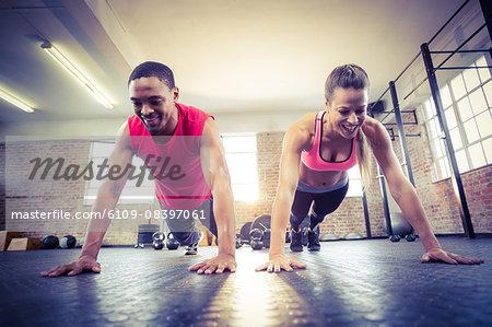 Fit couple doing push ups