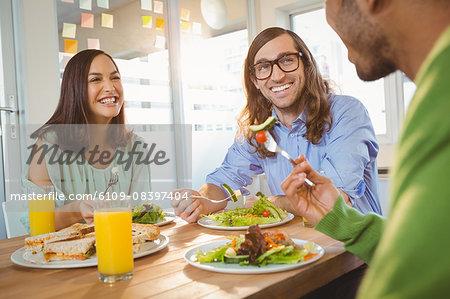 Creative business people having breakfast