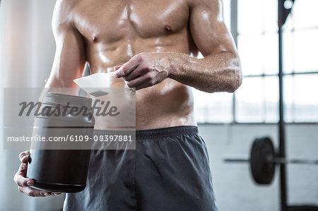 Fit man making his protein shake