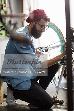 Bike mechanic repairing a bicycle