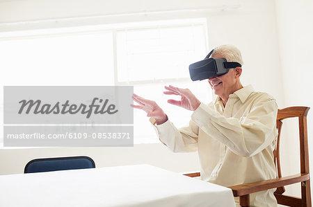 Senior man using an oculus rift