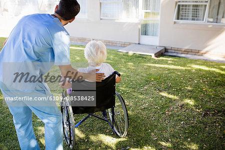 Nurse speaking with a senior woman