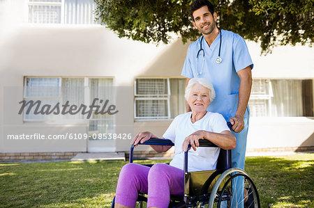 Nurse posing with a senior woman