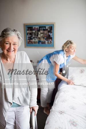 Nurse and senior woman are posing