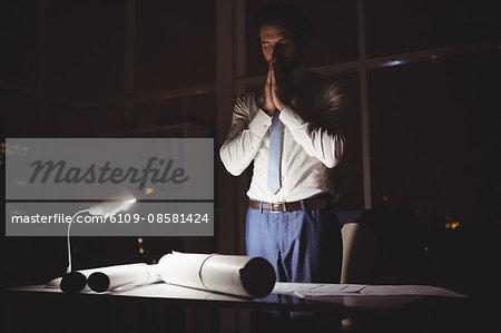 Overworked businessman working at night