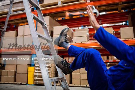 Worker falling down ladder