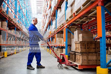 Man worker using pallet truck