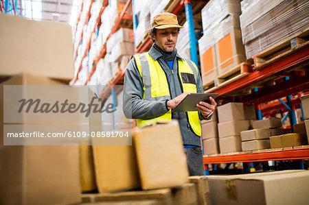 Worker using digital tablet