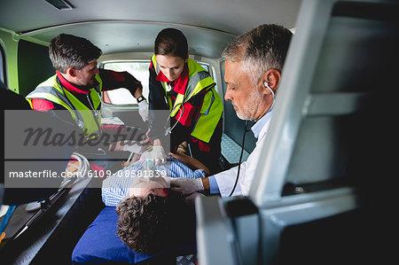 Injured man with ambulance men