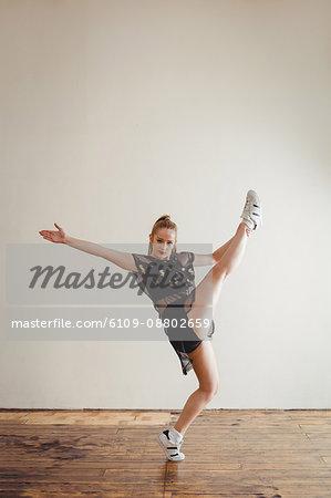 Portrait of a pretty woman practising hip hop dance in studio