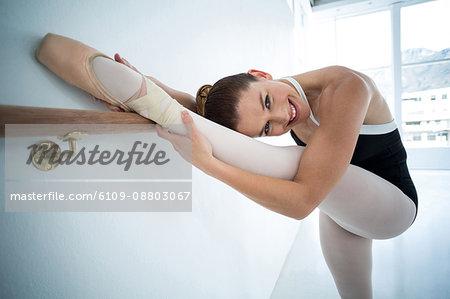 Portrait of ballerina practicing ballet dance in the studio