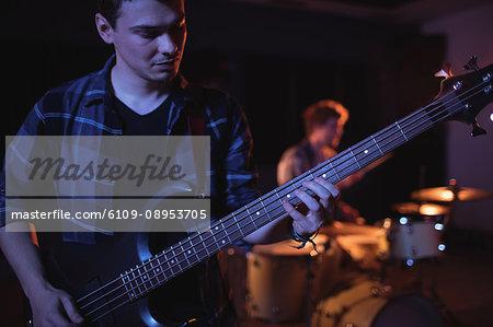 Guitarist playing electric guitar in recording studio