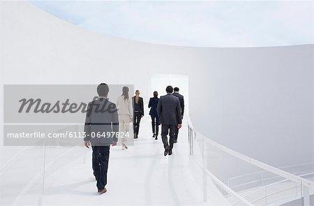 Business people walking toward doorway