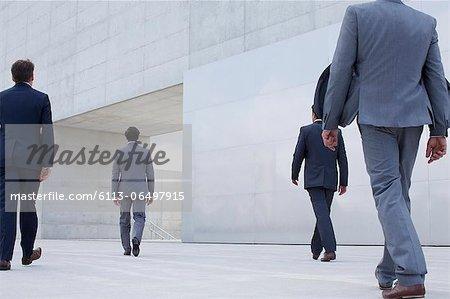 Businessmen walking toward cultural center