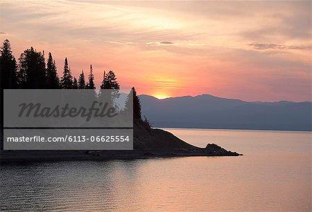 Sun setting over rural mountains