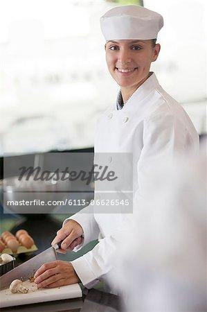 Chef chopping vegetables in restaurant kitchen